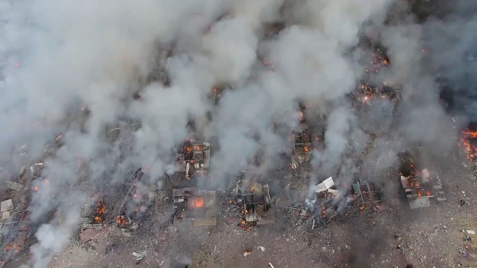 An overhead view of the fireworks market after the blast.