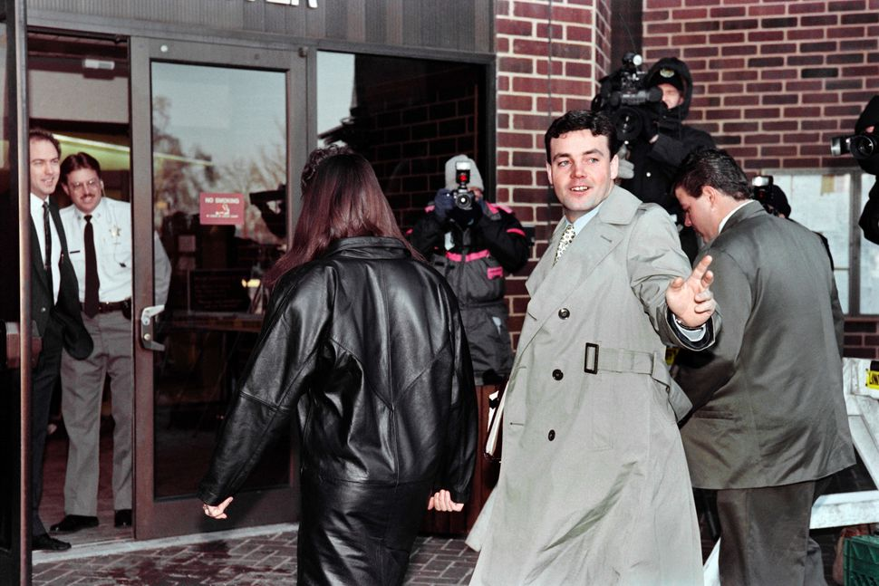 John Wayne Bobbitt arrives at the courthouse in Manassas, Virginia, for the fifth day of his wife's trial.