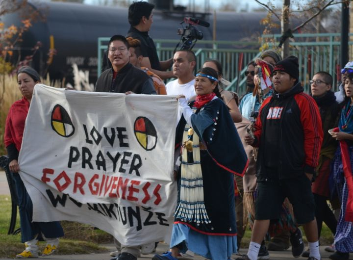 Water protectors on a forgiveness walk, where they prayed for the well-being of law enforcement officers, in Mandan, North Da