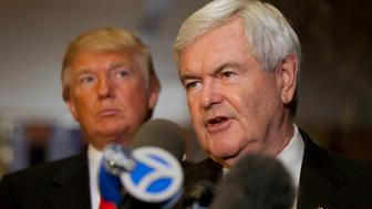 Republican presidential candidate Newt Gingrich (R) speaks to members of the media with Donald Trump after a meeting at Trump Towers on 5th Avenue in New York, December 5, 2011. REUTERS/Andrew Burton (UNITED STATES - Tags: POLITICS ELECTIONS)
