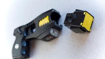 A police taser with copy-space.