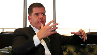 BOSTON - NOVEMBER 17: Mayor Marty Walsh and Chief Resilience Officer Dr. S. Atyia Martin speak during a sit down interview with the Boston Globe in the Mayor's office in Boston on Nov. 17, 2016. (Photo by Jessica Rinaldi/The Boston Globe via Getty Images)