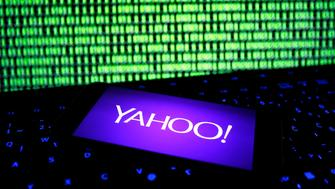 A photo illustration shows a Yahoo logo on a smartphone in front of a displayed cyber code and keyboard on December 15, 2016. REUTERS/Dado Ruvic/Illustration     TPX IMAGES OF THE DAY