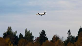 An Alaska Airlines plane approaches Seattle-Tacoma International Airport in SeaTac, Washington October 30, 2013. Voters in the working-class Seattle suburb of SeaTac, which encompasses the region's main airport, will decide on November 5, 2013 whether to enact one of the country's highest minimum wages in a ballot measure supporters hope will serve as a model for similar efforts elsewhere. Paul McElroy, a spokesman for SeaTac-based Alaska Airlines, which lost a court battle to keep a minimum wage initiative off the ballot, said its passage might prompt the airline to reroute some flights as a cost-saving measure. Amid debate about income inequality in America, the ballot initiative in SeaTac, Washington, would mandate that 6,300 workers at Sea-Tac International Airport and nearby hotels, car rental agencies and parking lots receive a minimum hourly wage of $15, more than double the current federal minimum wage of $7.25. Picture taken October 30, 2013. REUTERS/Jason Redmond (UNITED STATES - Tags: POLITICS BUSINESS TRANSPORT EMPLOYMENT)