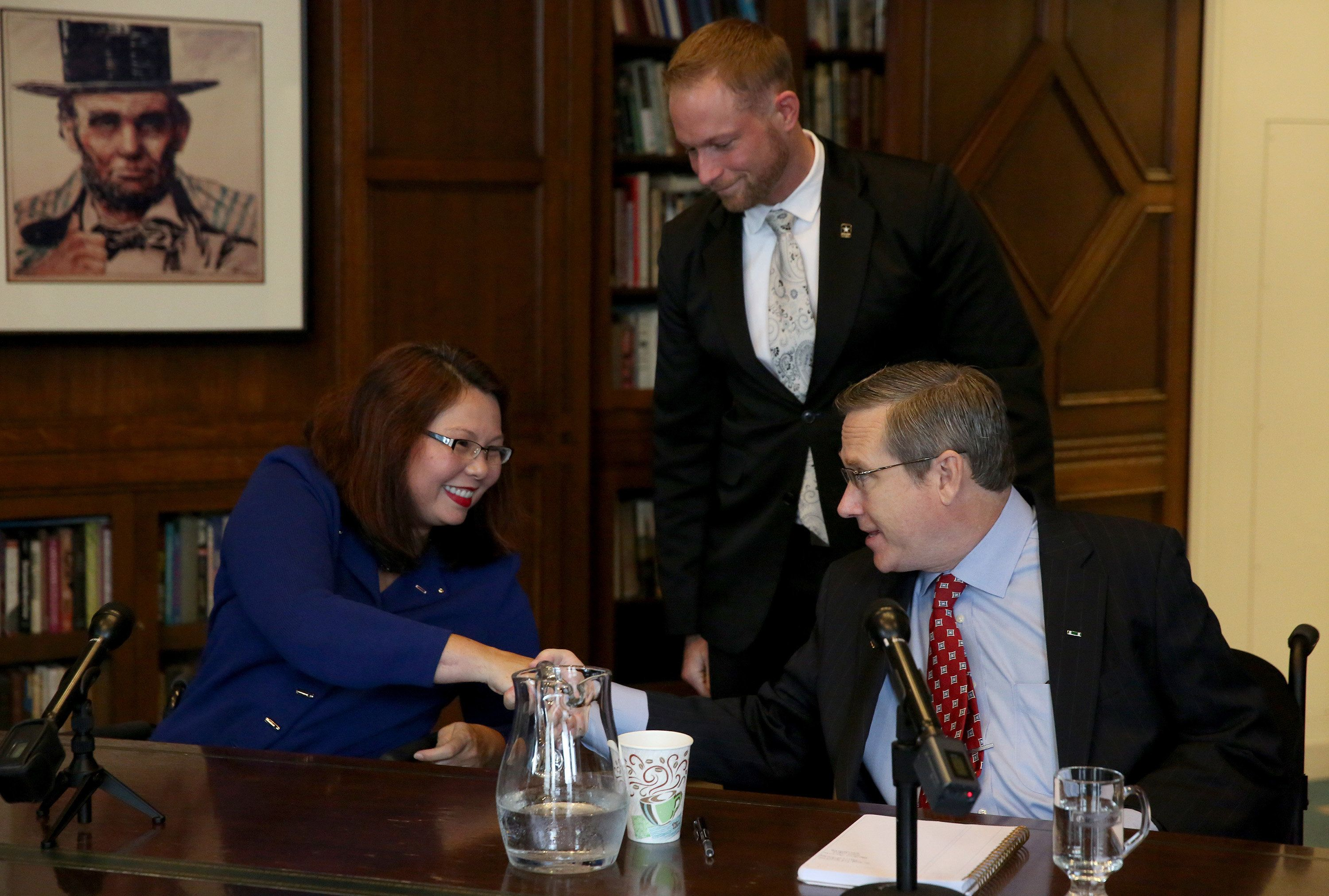 Rep. Tammy Duckworth and Sen. Mark Kirk shake hands after their debate on Monday Oct. 3, 3016 in the Chicago Tribune Editorial Board room. (Nancy Stone/Chicago Tribune/TNS via Getty Images)