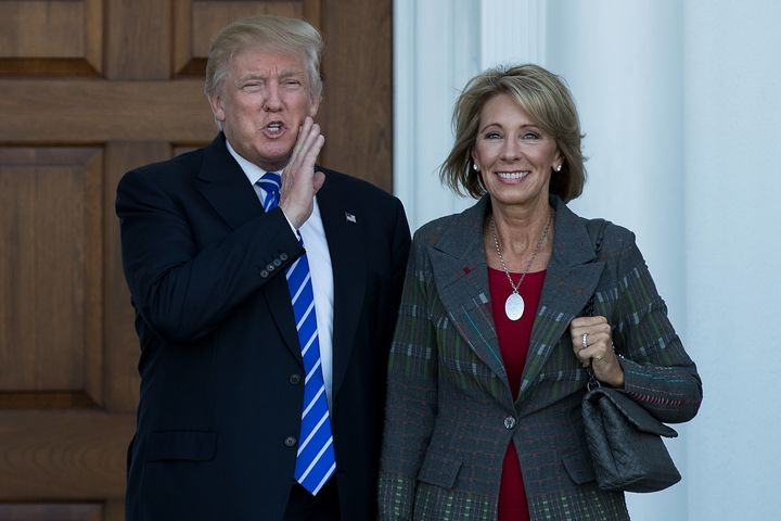 President-elect Donald Trump and his nominee for education secretary, Betsy DeVos, pose for a photo after their meeting at Tr