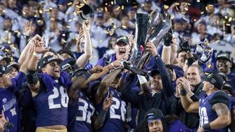 December 2, 2016; Santa Clara, CA, USA; Washington Huskies head coach Chris Petersen hoists the championship trophy after the Pac-12 championship against the Colorado Buffaloes at Levi's Stadium. The Huskies defeated the Buffaloes 41-10. Mandatory Credit: Kyle Terada-USA TODAY Sports
