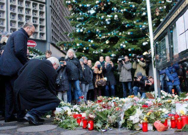 German Foreign Minister Frank-Walter Steinmeier and his Italian counterpart Angelino Alfano lay flowers...