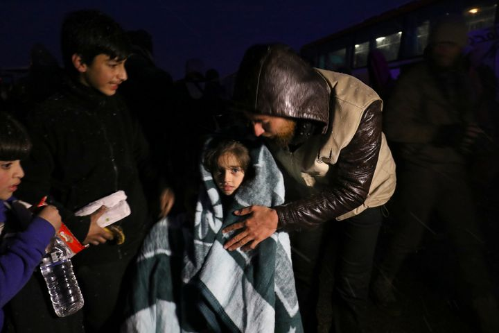 Evacuees from a rebel-held area of Aleppo arrived at insurgent-held al-Rashideen, Syriaon Wednesday.