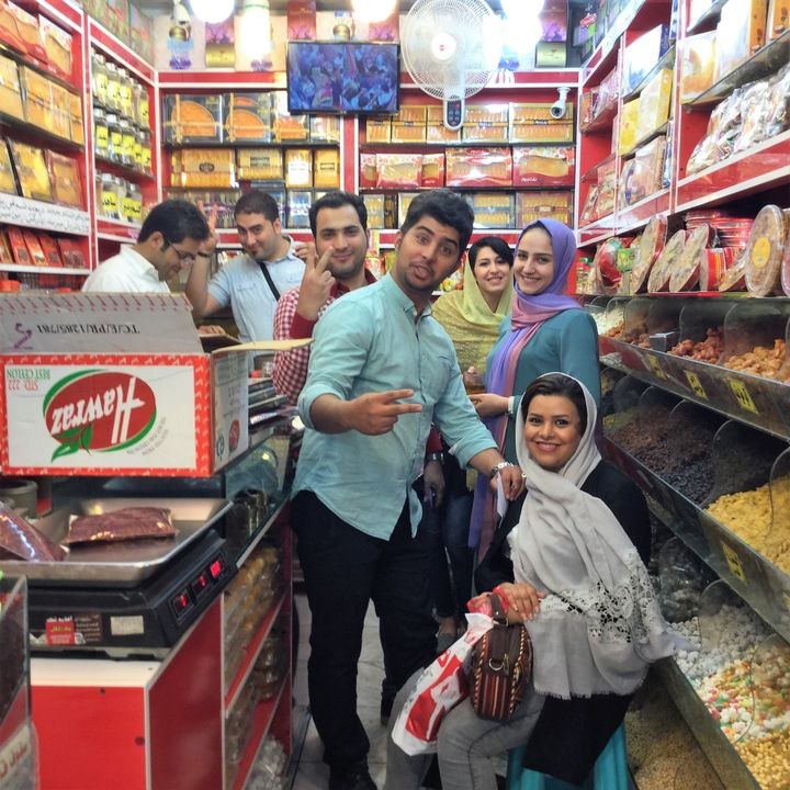 Shoppers in the bazaar in Mashhad, Iran; excited to meet an American