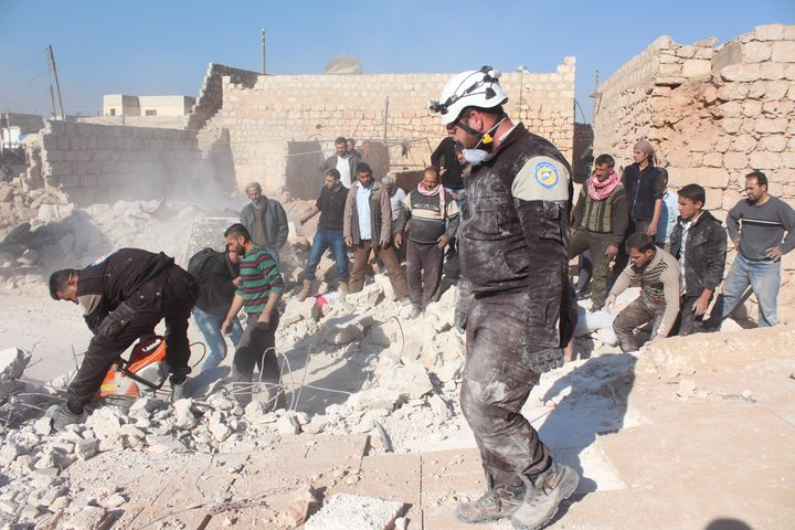 Civil defense members and citizens carry out search and rescue work in Aleppo, Syria on November 25, 2016.