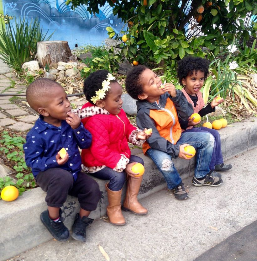 Curbside Kids Enjoying the fruit of Ron Finley's labor.