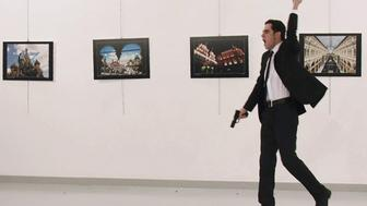 EDITORS NOTE: Graphic content / A picture taken on December 19, 2016 shows Mevlut Mert Altintas, the gunman who killed Russia's Ambassador to Turkey, during an attack during a public event in Ankara. A gunman crying 'Aleppo' and 'revenge' shot Karlov while he was visiting an art exhibition in Ankara on December 19, witnesses and media reports said. The Turkish state-run Anadolu news agency said the gunman had been 'neutralised' in a police operation, without giving further details.  / AFP / Sozcu daily / Yavuz Alatan / Turkey OUT        (Photo credit should read YAVUZ ALATAN/AFP/Getty Images)
