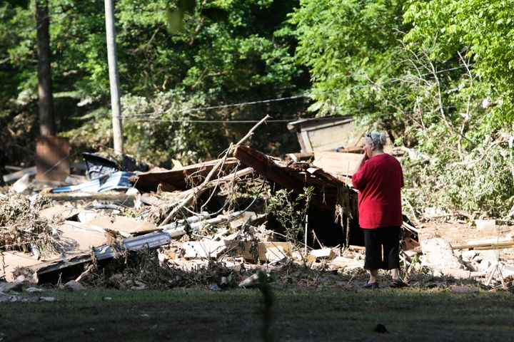 Emma Allen, 58, looks at the remnants of her damaged home after flooding in Falling Rock, West Virginia.