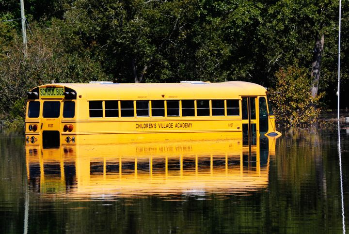 A school bus is partially submerged as the Neuse River floods following Hurricane Matthew in Kinston, North Carolina, Oct. 12