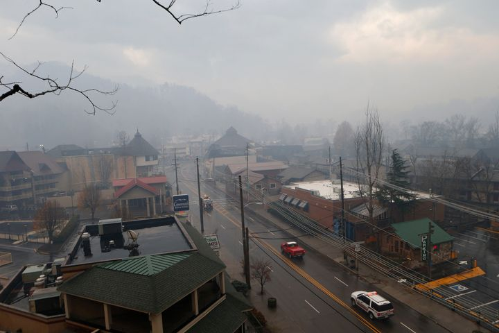 Smoke fills the air and surrounds businesses and resorts in the wake of a wildfire in downtown Gatlinburg, Tennessee, No