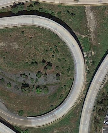 The wrecked vehicle was located in a field 30 feet below these two roadways.