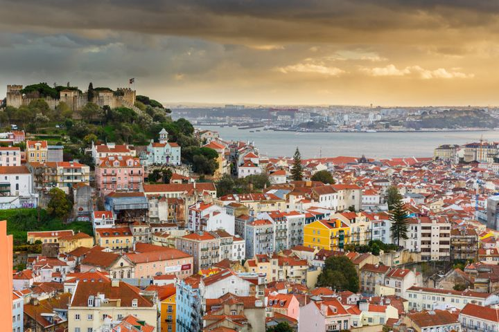 "Lisbon sits <a href=""https://www.britannica.com/place/Tagus-River"" target=""_blank"">near the Tagus River</a>."