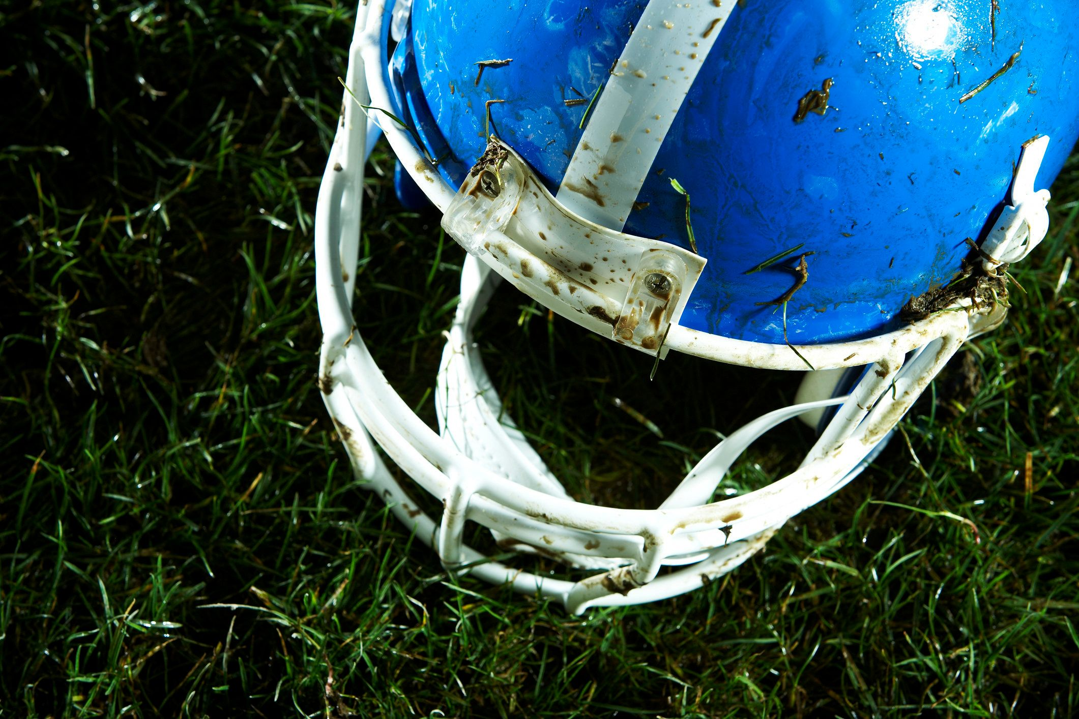 Football helmet on grass