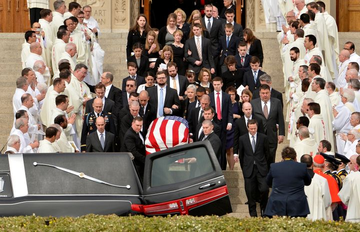 Pallbearers carry the casket of U.S. Supreme Court Associate Justice Antonin Scalia out of his funeral mass at the Basilica o