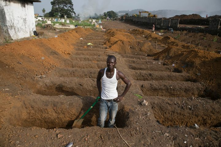 Scientists have developed an experimentalEbola vaccine after an outbreak in 2014 killed 11,000 people. Above, a grave digger prepares new graveson Dec. 21, 2014, at a cemetery in Freetown, Sierra Leone, where about 30 suspected Ebola victims were being buried per day during the epidemic.
