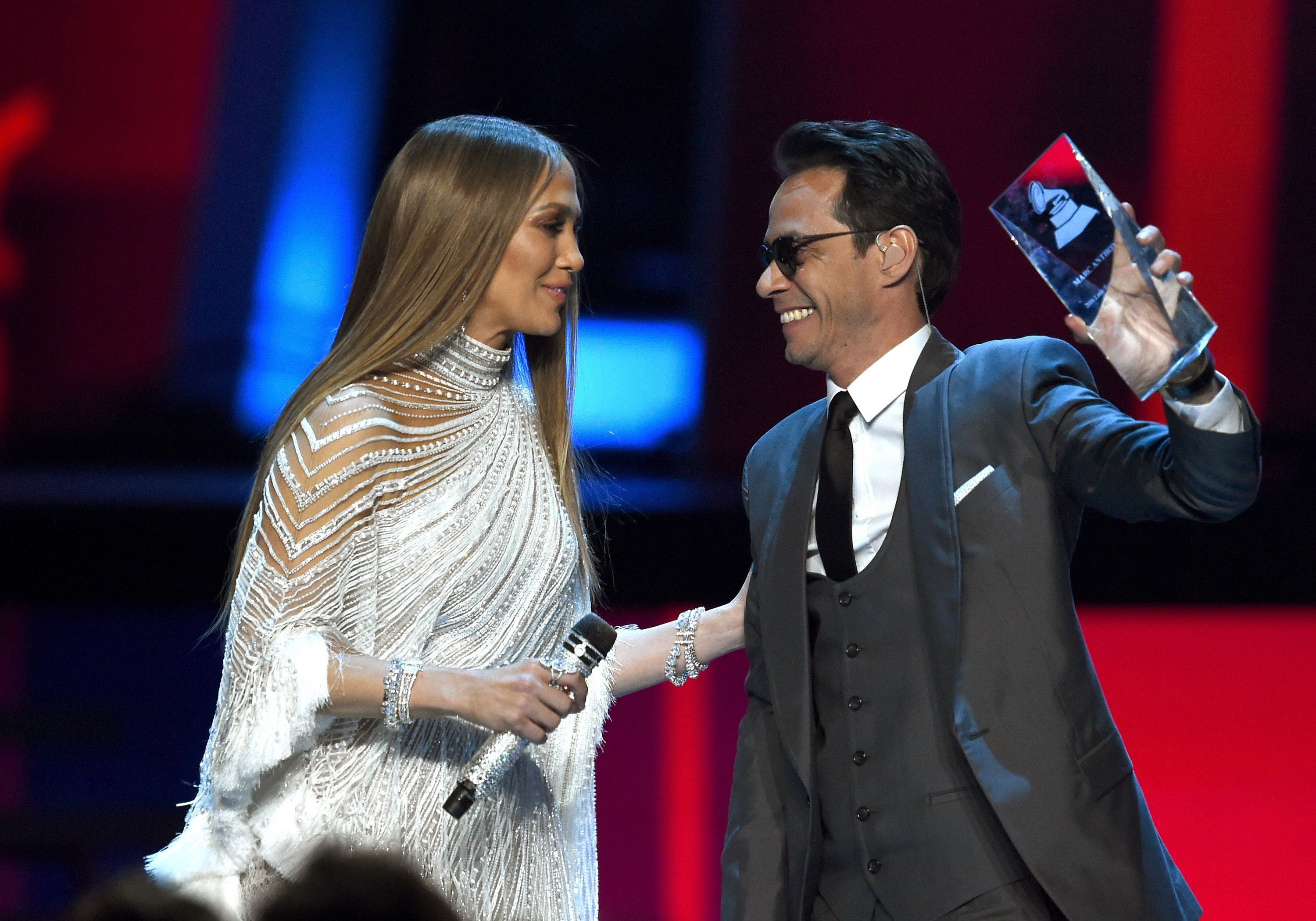 LAS VEGAS, NV - NOVEMBER 17:  Singer/actress Jennifer Lopez and Person of the Year award honoree Marc Anthony speak onstage during The 17th Annual Latin Grammy Awards at T-Mobile Arena on November 17, 2016 in Las Vegas, Nevada.  (Photo by Kevin Winter/WireImage)