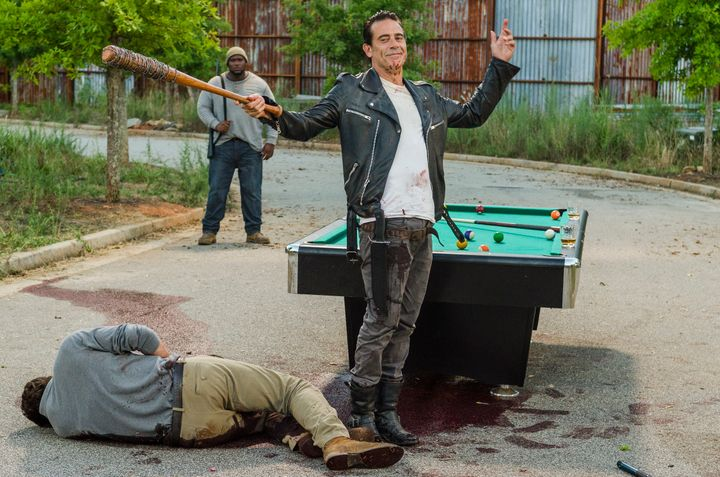 Negan finishes off a game of pool by switching to another favorite sport.