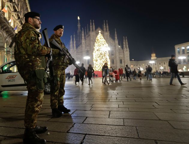 Italian soldiers patrol next to Milan's gothic cathedral, Italy, Thursday, Dec. 22, 2016. Following the...