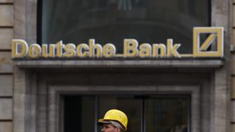 A construction worker walks past a branch of Germany's largest business bank, Deutsche Bank in Frankfurt, Germany, October 27, 2016.   REUTERS/Kai Pfaffenbach