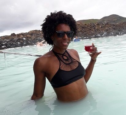 Enjoying a drink in the Blue Lagoon. Visitors can swim up to the bar to order smoothies and wine.