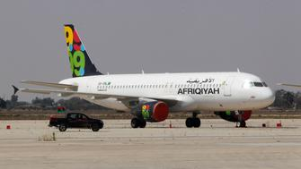 An Afriqiyah Airways aircraft is pictured at the Tripoli Airport , August 25, 2011. REUTERS/Louafi Larbi (LIBYA - Tags: TRANSPORT CONFLICT)