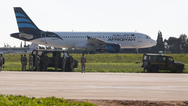 The airliner's engines were left running after it landed in