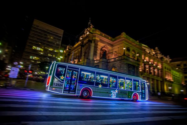 An illuminated bus drives along the streets of the old center of São Paulo on December 21, 2016.