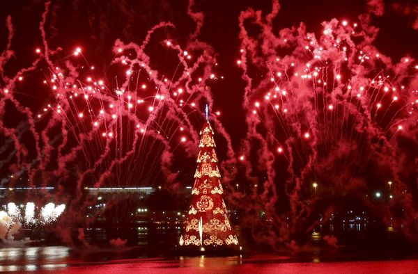 Fireworks explode around Rio's Christmas tree during its lighting ceremony at Rodrigo de Freitas Lagoon in Rio de Janeiro, Br