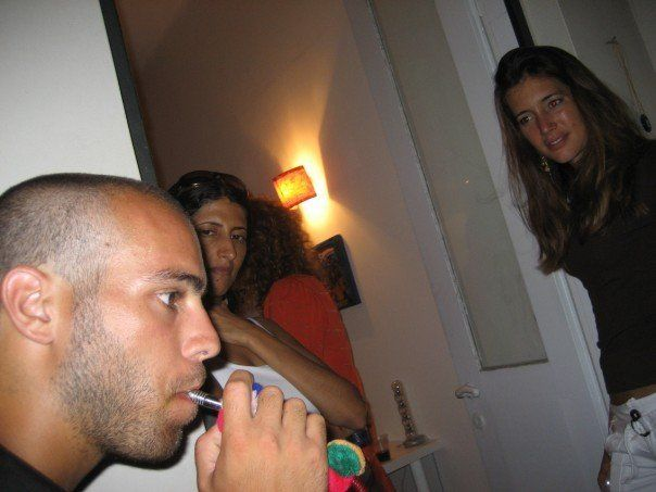 Smoking a water pipe, at a social gathering of locals and expatriates in Tel Aviv, Israel, in 2007.