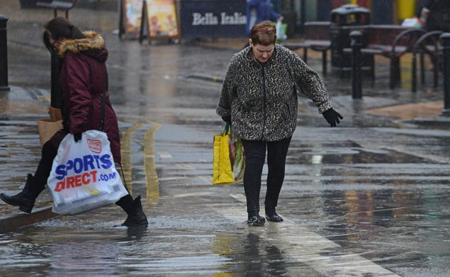 Shoppersin Blackpool, Lancs, were spotted wading through huge puddles in the town