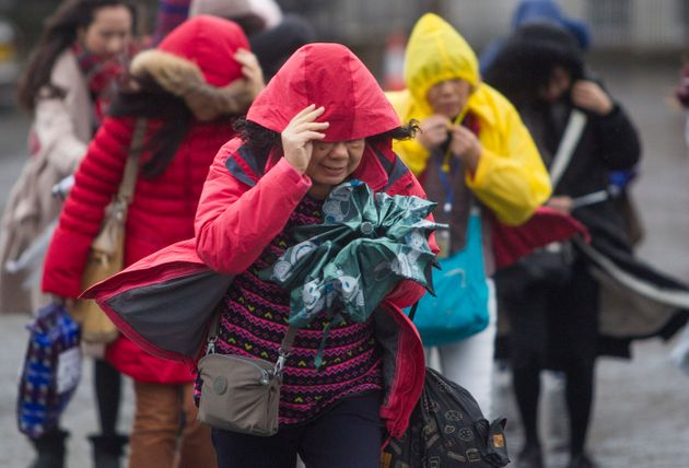 Visitors to Edinburgh's old city braved the gale force winds on