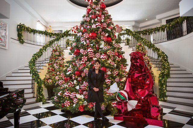 Jenner's giant Christmas tree greets guests in the entryway.