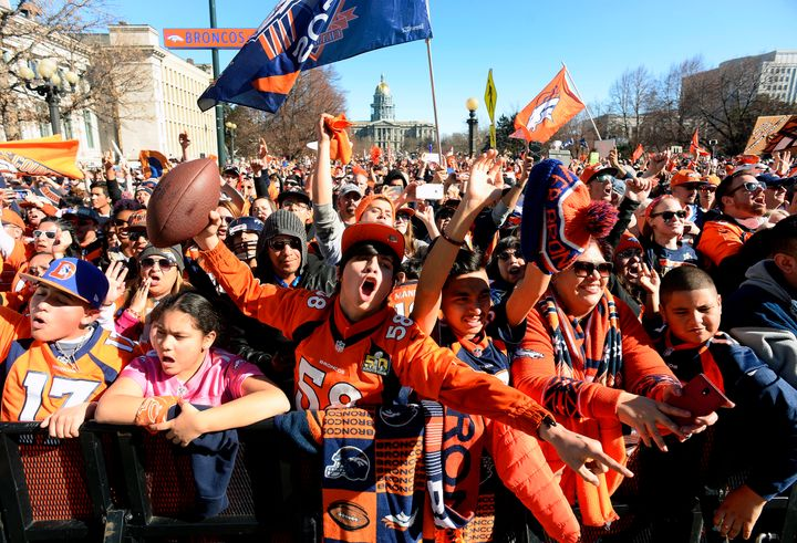 Fans cheer as Peyton Manning is introduced onstage during the Denver Broncos Super Bowl 50 victory rally in Civic Center Park