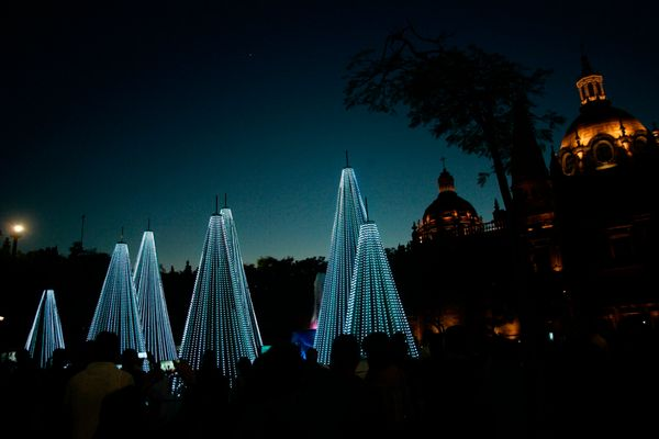 People enjoy a Christmas light display in Guadalajara, Mexico, on December 12, 2016.