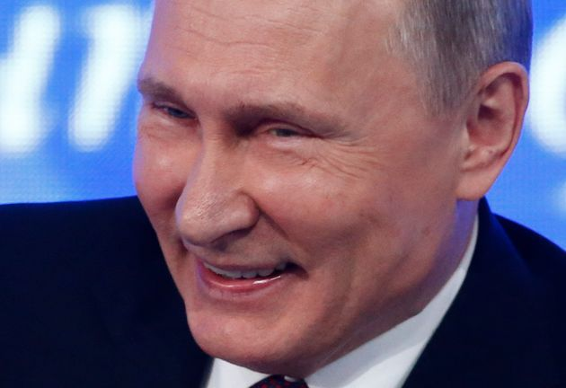 Putin gave a smile to reporters as he said Russia correctly predicted Donald Trump's