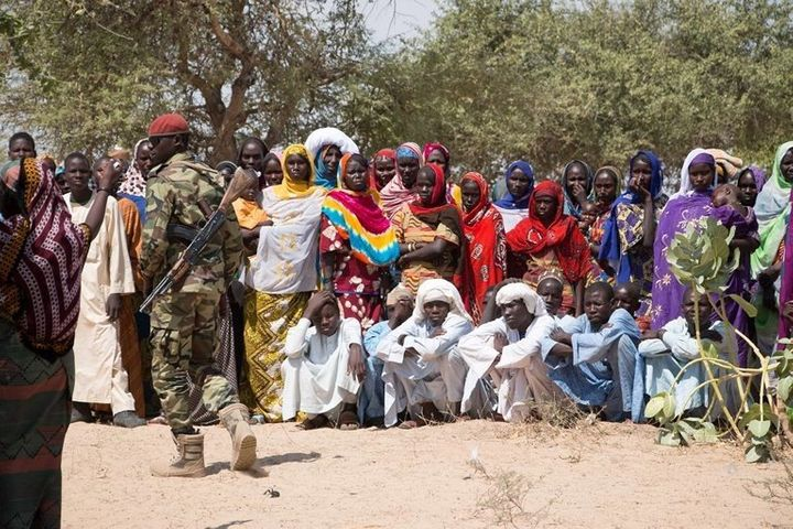 Chadian armed soldiers supervise aid distributions in the Lake Chad Basin.
