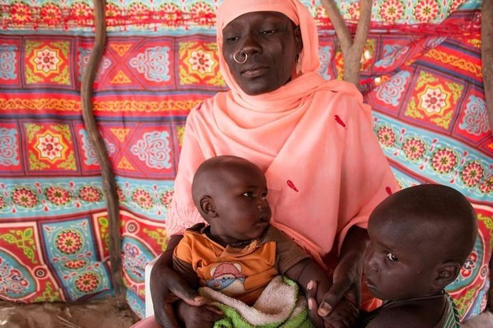 Haje Fanta, 28, from Niger, is caring for two of her children at the refugee camp.