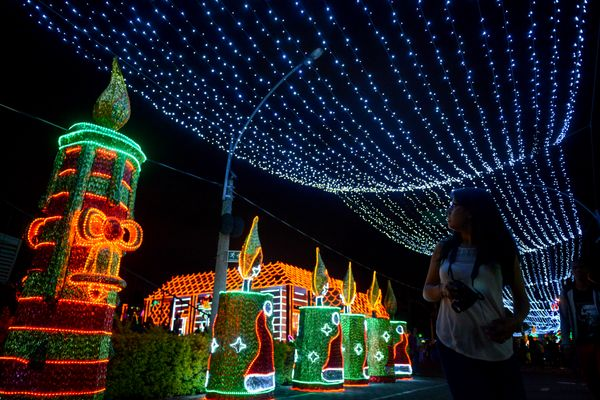 A woman looks at a Christmas light display in Medellín, Colombia, on December 16, 2016.