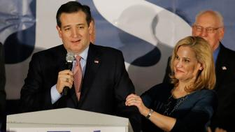 U.S. Republican presidential candidate Ted Cruz speaks, with his wife Heidi Cruz by his side, after winning at his Iowa caucus night rally in Des Moines, Iowa, February 1, 2016. REUTERS/Jim Young