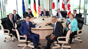 Participants of the G7 summit meetings (from front in clockwise) Japanese Prime Minister Shinzo Abe, French President Francois Hollande, Britain's Prime Minister David Cameron, Canadian Prime Minister Justin Trudeau, European Commission President Jean-Claude Juncker, European Council President Donald Tusk, Italy's Prime Minister Matteo Renzi, German Chancellor Angela Merkel and U.S. President Barack Obama attend session 2 meeting at the Shima Kanko Hotel in Shima, Mie Prefecture, Japan May 26, 2016.  REUTERS/Pool  JAPAN OUT