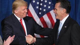 Businessman and real estate developer Donald Trump (L) greets U.S. Republican presidential candidate and former Massachusetts Governor Mitt Romney after endorsing his candidacy for president at the Trump Hotel in Las Vegas, Nevada February 2, 2012.  REUTERS/Steve Marcus (UNITED STATES  - Tags: POLITICS ELECTIONS BUSINESS)