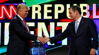 Donald Trump and Ted Cruz shake hands at the start of the Republican candidates debate sponsored by CNN at the University of Miami in Miami, Florida, March 10, 2016. REUTERS/Joe Skipper/File Photo