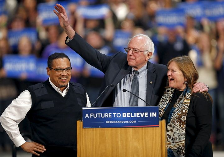 Bernie Sanders (C) stands on stage with his wife, Jane O'Meara Sanders (R), and U.S. Rep. Keith Ellison on Jan. 26, 2016.