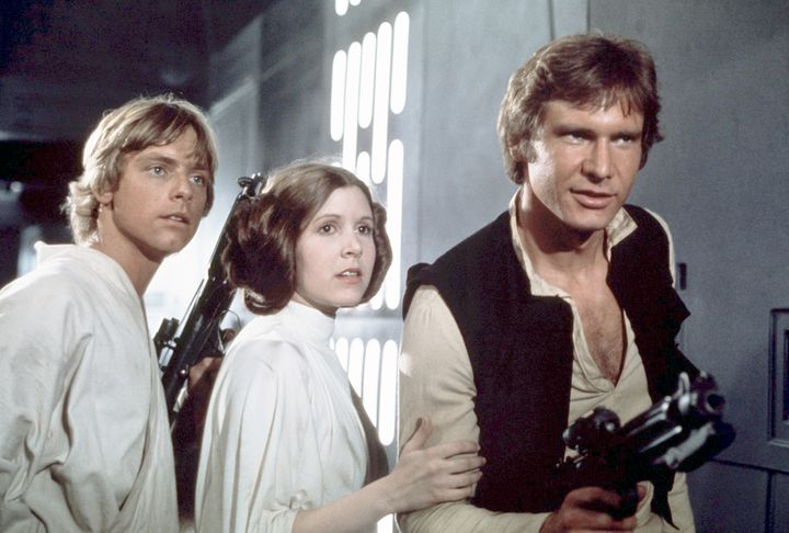 "Fisher, center, on the set of ""Star Wars: A New Hope."""